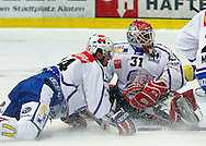 ZSC Lions goaltender Ari Sulander (R) and defender Pascal Mueller (L) are disappointed after receiving the second goal to the score of 2-0 during ice hockey game five of the Swiss National League A Playoff Quarterfinal between Kloten Flyers and ZSC Lions held at the Kolping Arena in Kloten, Switzerland, Tuesday, March 8, 2011. (Photo by Patrick B. Kraemer / MAGICPBK)