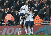 Football - 2017 / 2018 Premier League - Tottenham Hotspur vs. Arsenal<br /> <br /> Tottenham players surround Harry Kane (Tottenham FC)  after he scores the winning goal at Wembley Stadium.<br /> <br /> COLORSPORT/DANIEL BEARHAM