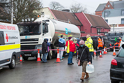 © Licensed to London News Pictures; 23/12/2020; Bristol, UK. People collect water from a tanker in Bristol after several local water mains burst last night, cutting water to around 5000 people during the Covid-19 coronavirus pandemic in the UK, and in the run up to Christmas. The Red Cross were on hand to provide assistance. Photo credit: Simon Chapman/LNP.