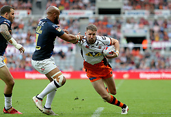 Castleford Tigers Michael Shenton is tackled by Leeds Rhino's Jamie Jones-Buchanan during the Betfred Super League, Magic Weekend match at St James' Park, Newcastle.