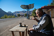 A gas station attendant sits outside his station to drink coffee in Yeghegnadzor, Armenia. The second cup is for a photographer he saw walking past and who he invited to drink as well. Photo taken near the turn-off to Getap.