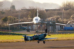 "© Licensed to London News Pictures. File picture dated 13/12/2012. Bristol, UK. The Mark IX Spitfire circa 1943 taking off past Concorde at Filton Airfield. Engineers race to finish work rebuilding a Mark IX Spitfire fighter circa 1943, at Filton airfield near Bristol. The plane has been rebuilt  by John Hart engineering, it is the last plane to be completed at the airfield and was flown out on 18 December 2012 by pilot Bill Perrins. Filton, the birthplace of the British-built Concorde jets, is to close on Friday (21st December 2012). Its owner BAE Systems says it is not viable and intends to sell it for housing and business development. BAE Systems said the airfield was closing following a comprehensive assessment over a five-year period and an independent review, ""both of which concluded that the airfield was not economically viable"".  Airbus has said it is fully committed to the Filton site, where it has a base making aircraft wings.  A spokesman said: ""The closure of the airfield will have no significant effect on our business and we have mitigation plans in place regarding the change of venue for our passenger shuttle (using Bristol airport) and the transportation of the A400M wings (via Portbury docks).  Planes currently based at Filton will have to find new homes. The airfield officially closes for flights this Friday, though the police helicopter will still be based there. BAE is supporting a new museum at Filton to ""house Concorde Alpha-Foxtrot and Bristol's aviation heritage."".Photo credit : Simon Chapman/LNP"