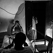Members of the Akasha household spend time with each other after eating Sunday night dinner in the dark during one of Khartoum's nightly power outages in Sudan on December 14, 2020. Two years after a revolution gave way to the end of Omar al-Bashir's 30-year rule, the new government inherited a bankrupt state, burdened by the consequences of international sanctions. Although assisted by the World Bank and the IMF, the country remains mired in the economic crisis.