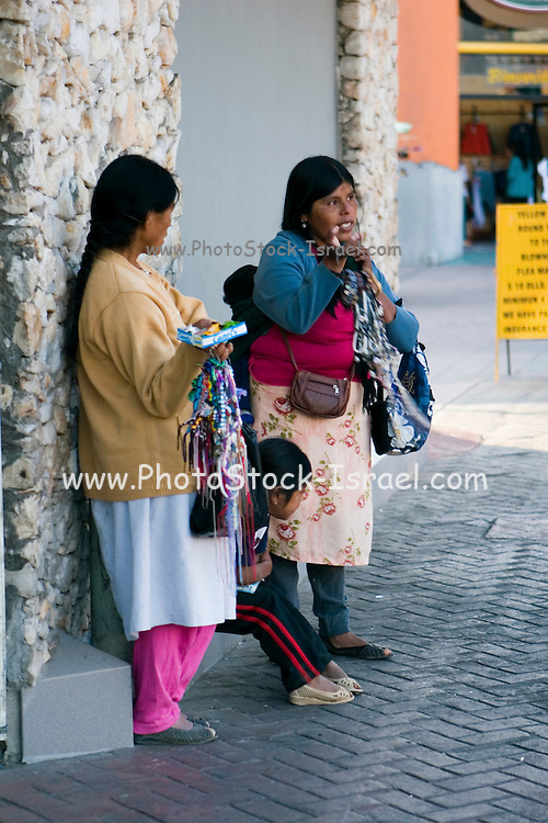 Mexico female beggars selling to tourists , Ensenada
