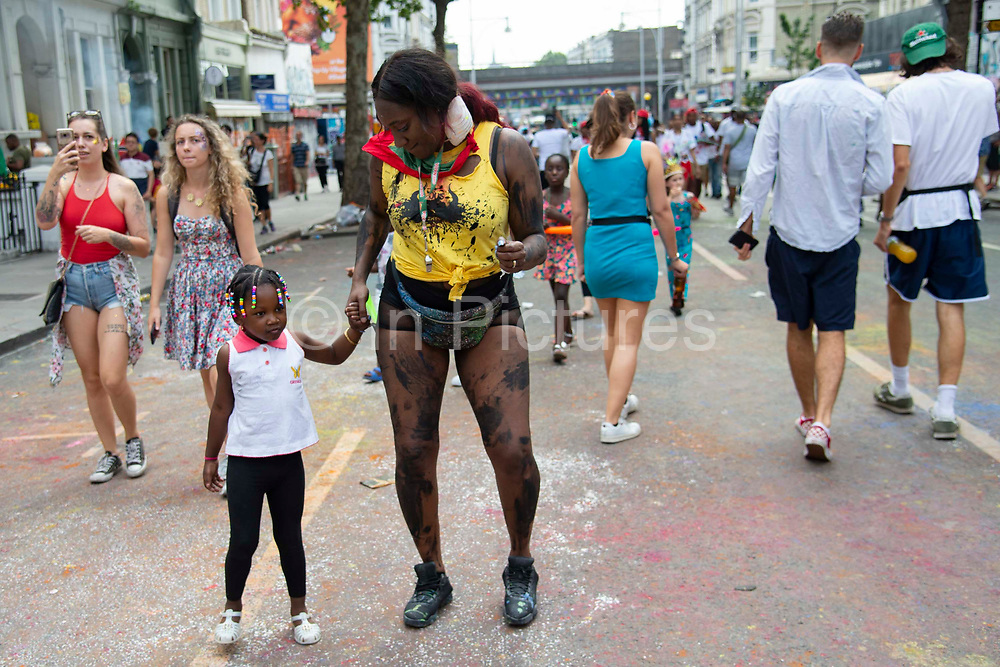 Party goers at the Notting Hill Carnival, on 25th August, 2019 in London, United Kingdom. One million people are expected on the streets in scorching temperatures for the Notting Hill Carnival, Europes largest street party and a celebration of Caribbean traditions.