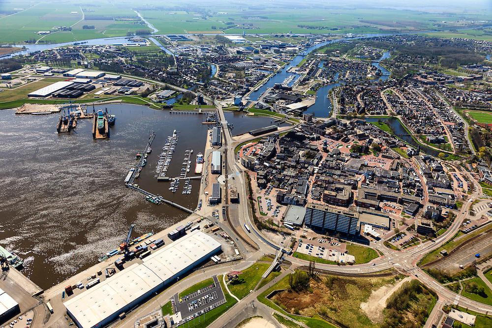 Nederland, Groningen, Delfzijl, 01-05-2013; overzicht centrum van Delfzijl, gezien naar Eemskanaal. Links haven Delfzijl met droogdokken en jachthaven Neptunus.<br /> Town centre and Delfzijl harbor with docks and marina Neptune. In the background the Ems.<br /> luchtfoto (toeslag op standard tarieven);<br /> aerial photo (additional fee required);<br /> copyright foto/photo Siebe Swart