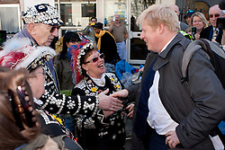 © Licensed to London News Pictures. 08/03/2012. London, UK. Mayor of London Boris Johnson pictured with two Pearly Queens at the Roman Road Market in Bow today (08/03) to publicise the eastern extension of the Barclays Bike cycle hire scheme which launches today. Photo credit : James Gourley/LNP