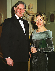 MR & MRS BILL CASH he is the MP at a ball in London on 12th March 1999.MPH 34