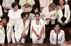 House Democratic women including U.S. Representative Alexandria Ocasio-Cortez (Center) are dressed in white for President Trump 's State of the Union address to a joint session of the U.S. Congress on Capitol Hill February 5, 2019 in Washington, DC. DC.Photo by Olivier Douliery/ABACAPRESS.COM