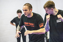 Stef Noij, KMG Instructor from the Institute Krav Maga Netherlands, warming up the students at the IKMS G Level Programme seminar today at the Scottish Martial Arts Centre, Alloa.