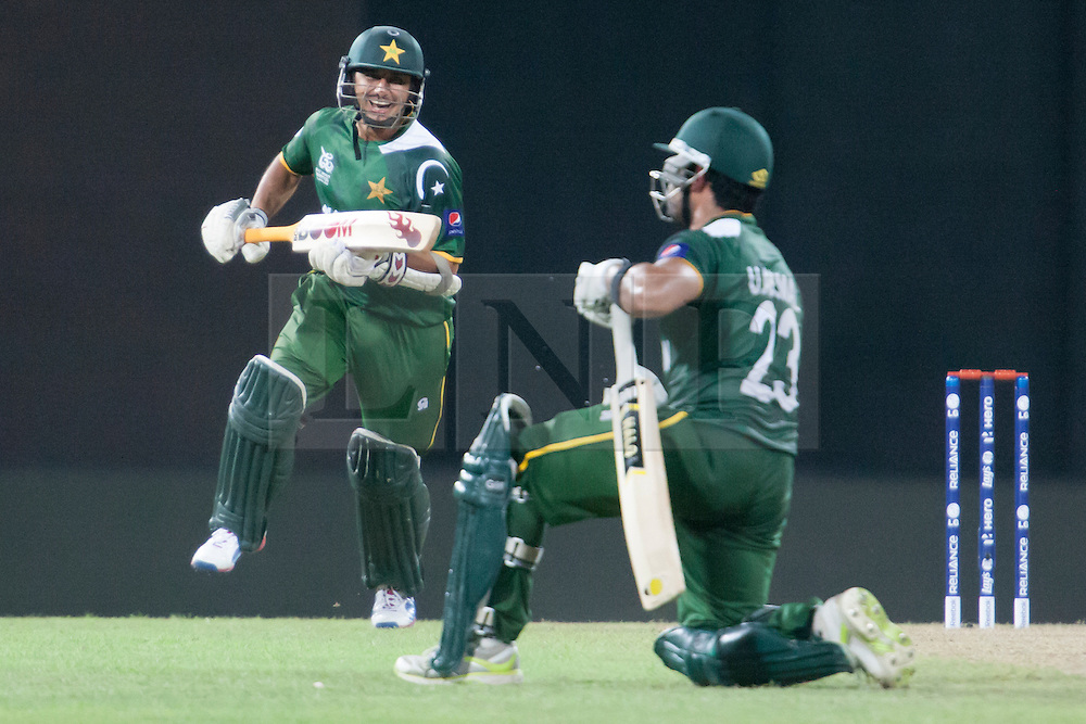 © Licensed to London News Pictures. 28/09/2012. Pakistani batsmen Saeed Ajmal runs towards Umar Akmal in celebration after their close win against South Africa during the T20 Cricket World cup match between South Africa Vs Pakistan at the R.Premadasa Cricket Stadium,Colombo. Photo credit : Asanka Brendon Ratnayake/LNP