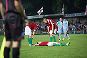 Karpatalya team mates see to György Toma who was tackled in the penalty box. A 4 - 2 victory for Karpatalya red against Szekely Land blue during the Conifa Paddy Power World Football Cup semi finals on the 7th June 2018 at Carshalton Athletic Football Club in the United Kingdom. The CONIFA World Football Cup is an international football tournament organised by CONIFA, an umbrella association for states, minorities, stateless peoples and regions unaffiliated with FIFA.