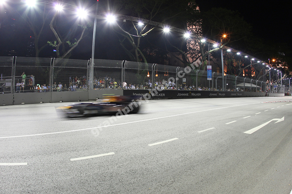 Red Bull - Renault  scenic picture of car driving pass spectateres before the Singapore Grand Prix 2009. Photo: Grand Prix Photo