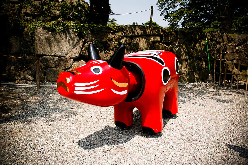 AIZUWAKAMATSU - JAPAN - Sculpture of a red cow (Akabeco) with mobile head This is normaly a traditionnal toy and became the symbol of the Aizu prefecture of Japan. - August 2005