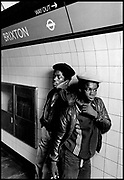 Youths standing on Brixton underground station. Photo by Richard Saunders 1983