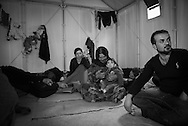 A Kurdish family from Al Hasakah, Syria rest in their shelter at Kara Tepe camp near Mytilene, Lesbos, Greece. The camp was established for refugees transiting through Lesbos on their way from Turkey to the heart of Europe.