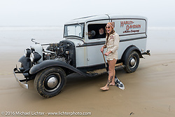 Ace flagger Sara Violette on a short break by the Ford panel truck at TROG West - The Race of Gentlemen. Pismo Beach, CA, USA. Saturday October 15, 2016. Photography ©2016 Michael Lichter.