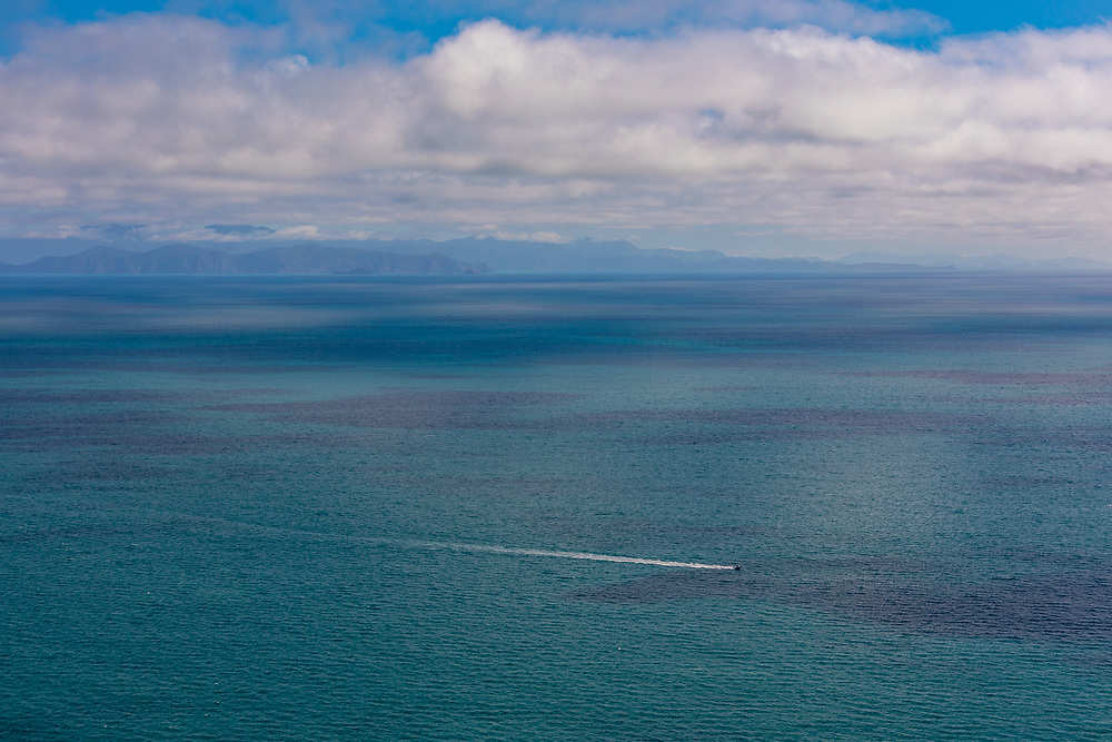 from high above the west coast out of wellington and looking across to the south island