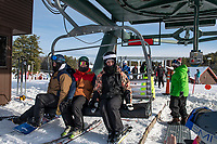 Alex Waite, Evan Griffin and Sam Bonner take the Ramrod Quad for their first run on opening day at Gunstock Mountain Resort Friday.  (Karen Bobotas Photo/for The Laconia Daily Sun)