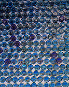 Wall of the Bottle House built in 1906 by miner Tom Kelly using some 50,000 beer and liquor bottles, ghost town of Ryholite, Nevada.