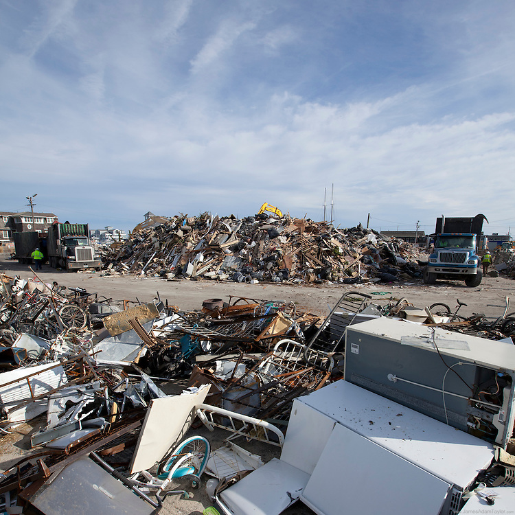 A vacant lot on Long Beach Island is the collection point for storm damaged property from roadside clean up where bulldozers and Excavators move and sort debris