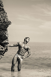 hot muscular man in the ocean