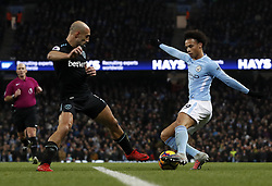 West Ham United's Pablo Zabaleta (left) and Manchester City's Leroy Sane (right) battle for the ball during the Premier League match at the Etihad Stadium, Manchester.
