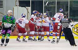 Players of Salzburg celebrate during ice-hockey match between HDD Tilia Olimpija Ljubljana (SLO) and EC Red Bull Salzburg (AUT) in 2nd Quaterfinals of EBEL league, on March 1, 2011 in Hala Tivoli, Ljubljana, Slovenia. (Photo By Vid Ponikvar / Sportida.com)
