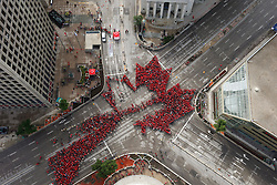 """Winnipeggers got together today to celebrate Canada's 150th birthday by forming a """"Living Leaf"""" at the historic downtown intersection of Portage and Main, Saturday, July 1, 2017. Organizers said that 4000 people showed up to show off their love for Canada. Photo by John Woods/CP/ABACAPRESS.COM"""