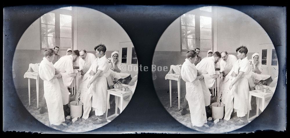 leg amputation in hospital operation room circa 1920s
