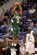 Cleveland State guard Brehohn Watson (12) puts up a three pointer, as Kansas State's Jermaine Maybank (23) watches from the bench in the first half at Bramlage Coliseum in Manhattan, Kansas, December 5, 2006.  K-State beat Cleveland State 93-60.<br />