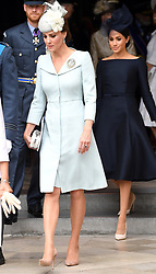 Catherine, Duchess of Cambridge (left) and Meghan, Duchess of Sussex during the RAF Centenary at Buckingham Palace, London. Photo credit should read: Doug Peters/EMPICS