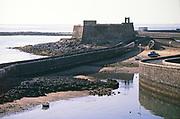 Fishing boats in small harbour at Castillo de San Gabriel, Arrecife, Las Palmas, Lanzarote, Spain 1979