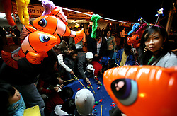 03 Feb 2006. East New Orleans, Louisiana.<br />  Tet, or Tet Nguyen Dan, Vietnamese Lunar New Year. Year of the Dog celebrations amongst the Vietnamese community of East Orleans. Children and their parents hook fish from a pool winning prizes like inflatable Nemos hanging from the fairground like attraction. Photo; Charlie Varley/varleypix.com