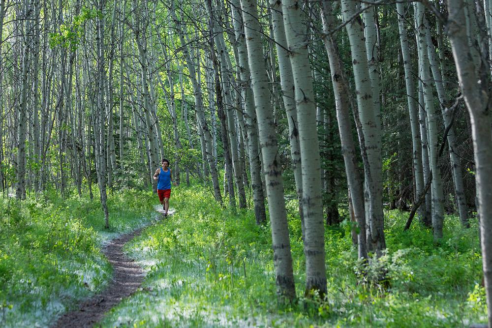 Tim Banfield trail running in Fish Creek Park, Calgary, AB