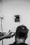 """2015/03/13 - Pile, Ecuador: Manuel Lopez cuts the hair of of his customers at his house in Pile. Manuel is one of the finest craftsmen of the """"Montecristi hat"""" but to make enough many to support his family he is also the only barber on the village. It will take him on average 3 months to weave one hat, which he will sell it by around US$700, but later on in the US and in Europe can reach the price tag of US$25,000.  UNESCO declared the """"Montecristi hat"""" in 2012 as Intangible Cultural Heritage of Humanity."""