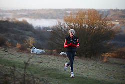© Licensed to London News Pictures. 16/02/2014. Winchester, Hampshire, UK. A runner on St. Catherine's Hill near Winchester at sunrise this morning, 16th February 2014. The welcomed sunshine offers respite to the seemingly never ending stormy period experienced in the UK. Photo credit : Rob Arnold/LNP