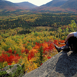 Lookout Ledge, Baxter S.P., ME. Fall foliage. Hikers. Looking out at the fall colors of the Wassataquoik Valley.