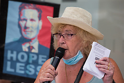 London, UK. 20th July, 2021. Former Bristol Labour councillor Harriet Bradley addresses supporters of left-wing Labour Party groups at a protest lobby outside the party's headquarters. The lobby was organised to coincide with a Labour Party National Executive Committee meeting during which it was asked to proscribe four organisations, Resist, Labour Against the Witchhunt, Labour In Exile and Socialist Appeal, members of which could then be automatically expelled from the Labour Party.