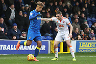 AFC Wimbledon striker Lyle Taylor (33) holding up the ball during the EFL Sky Bet League 1 match between AFC Wimbledon and Blackpool at the Cherry Red Records Stadium, Kingston, England on 20 January 2018. Photo by Matthew Redman.