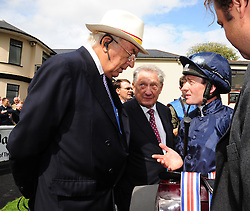 Owners John Magnier and Derrick Smith talk with jockey Seamus Heffernan after he rode Caravaggio to victory in the Keeneland Phoenix Stakes at Curragh Racecourse, Co. Kildare, Ireland.