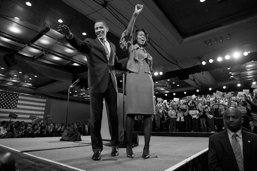 Illinois U.S. Senator Barack Obama, his wife Michelle wave to supporters as they celebrate his Super Tuesday victories with supporters at the Hyatt Regency in Chicago.