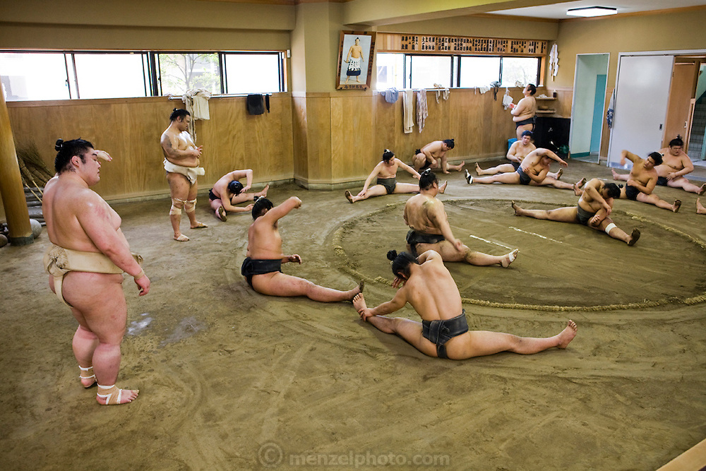 Wrestlers of the Professional Sumo Team (Musahigawa Beya) go through practice routines at their stable in Tokyo, Japan.  Sumos cook and eat chanko nabe, a stew pot of vegetable and meat or fish, at nearly every meal. It  is eaten with copious amounts of rice and numerous side dishes. Miyabiyama eats now to maintain his weight rather than to gain it, unlike the younger less gargantuan wrestlers in his stable who are eating a lot to pack on weight.