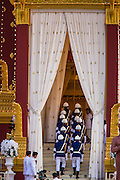 """04 FEBRUARY 2013 - PHNOM PENH, CAMBODIA:   The Cambodian Honor Guard marches into the crematorium during the cremation of King-Father Norodom Sihanouk in Phnom Penh. Norodom Sihanouk (31 October 1922- 15 October 2012) was the King of Cambodia from 1941 to 1955 and again from 1993 to 2004. He was the effective ruler of Cambodia from 1953 to 1970. After his second abdication in 2004, he was given the honorific of """"The King-Father of Cambodia."""" Sihanouk died in Beijing, China, where he was receiving medical care, on Oct. 15, 2012.  PHOTO BY JACK KURTZ"""