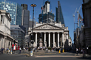 Old architecture of the Royal Exchange and the Bank of England competes with new high rise modern glass buildings in the City of London, England, United Kingdom. As Londons financial district grows in height, the classical buildings with their columns are being dwarfed by the towers and skyscrapers of glass.