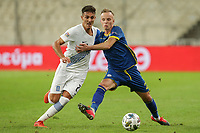 ATHENS, GREECE - OCTOBER 14: Dimitris Giannoulisof Greece and Florent Hadergjonajof Kosovo during the UEFA Nations League group stage match between Greece and Kosovo at OACA Spyros Louis on October 14, 2020 in Athens, Greece. (Photo by MB Media)