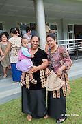 Tongans leaving Sunday service at King's Church, Nuku'alofa, Kingdom of Tonga, South Pacific, dressed in Sunday best, including kiekie ( woven pandanus belt / skirt )