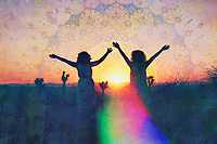 We are so happy together to receive this beautiful day. Two women in a rainbow Sunrise.