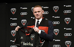 English international soccer player Wayne Rooney poses during the media unveiling at the Newseum in Washington, DC.