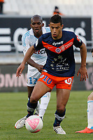 FOOTBALL - FRENCH CHAMPIONSHIP 2011/2012 - L1 - OLYMPIQUE MARSEILLE v MONTPELLIER HSC - 11/04/2012 - PHOTO PHILIPPE LAURENSON / DPPI - CHARLES KABORE (OM) / YOUNES BELHANDA (MON)